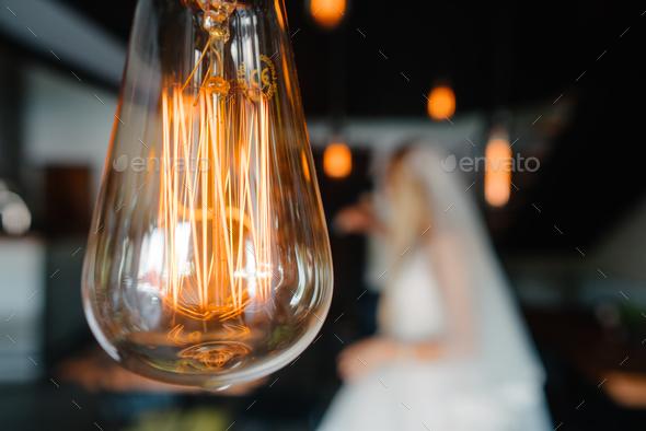 retro bulbs lights. newlyweds couple embracing - Stock Photo - Images