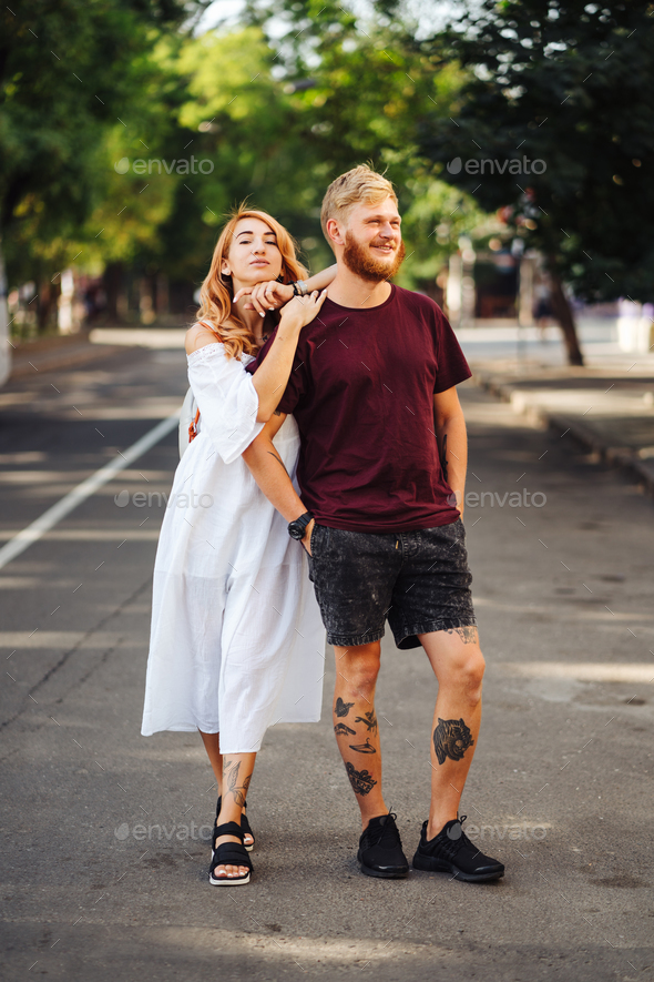 beautiful couple posing outdoors - Stock Photo - Images