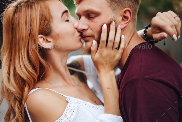 beautiful couple posing outdoors, close view - Stock Photo - Images