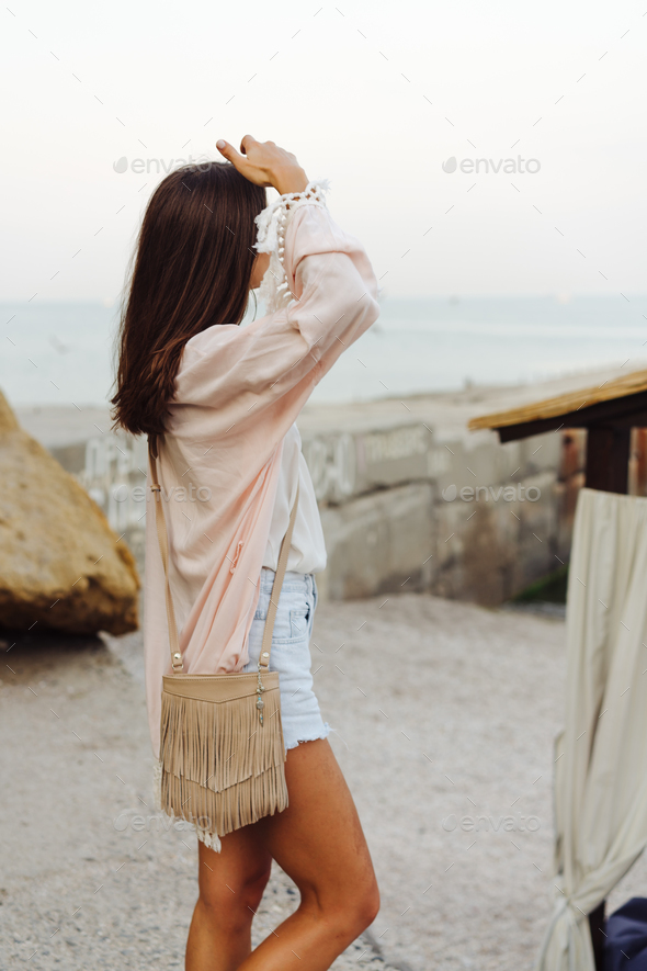 Young stylish girl wearing shorts and jacket - Stock Photo - Images