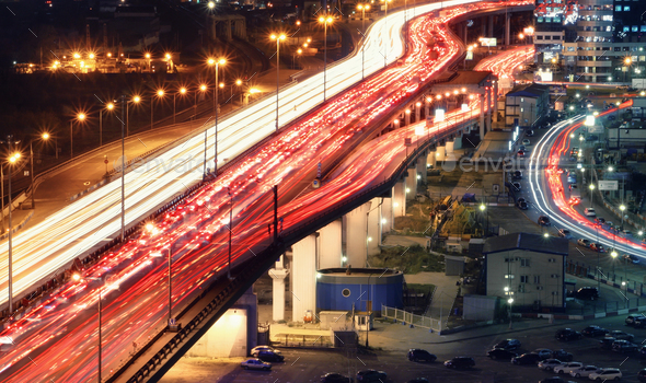 Traffic jam on automobile overpass at night - Stock Photo - Images