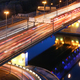 Road bridge across the river at night, view from above. light trails of cars on a highway. - PhotoDune Item for Sale