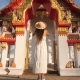 Young Tourist Girl in White Dress and Big Straw Hat Taking Photo with Mobile Phone of Thai Buddhist - VideoHive Item for Sale