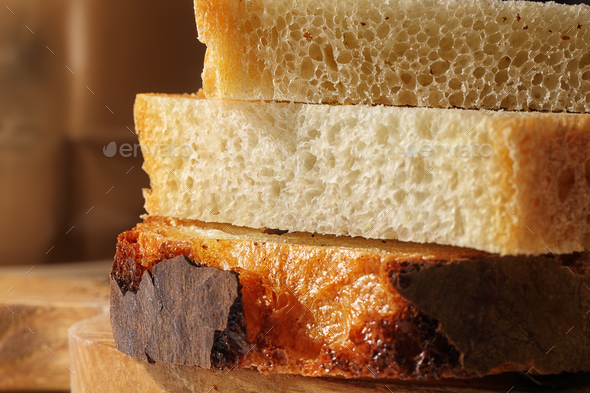fresh delicious slices of wheat bread - Stock Photo - Images