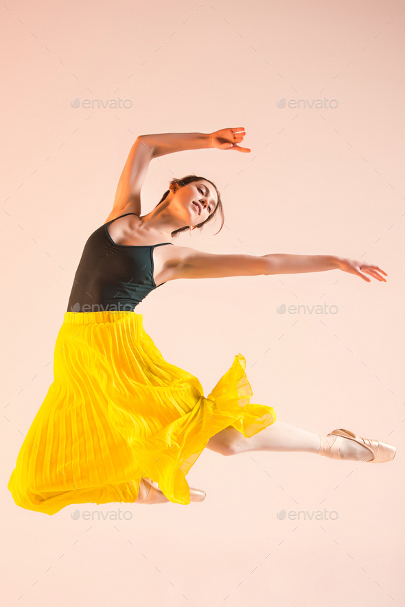 Young and incredibly beautiful ballerina is dancing at studio - Stock Photo - Images