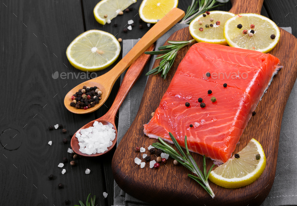 Fresh salmon fillet with spices and lemon. - Stock Photo - Images