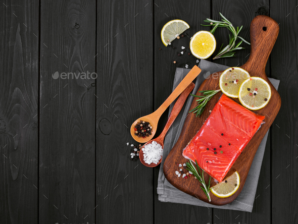 Fillet of salmon on cutting board - Stock Photo - Images