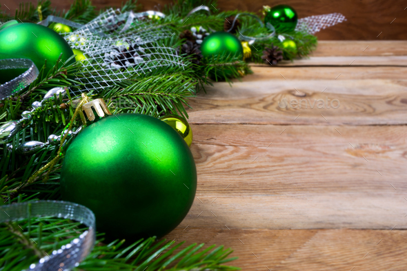 Christmas green baubles on wooden background, copy space - Stock Photo - Images