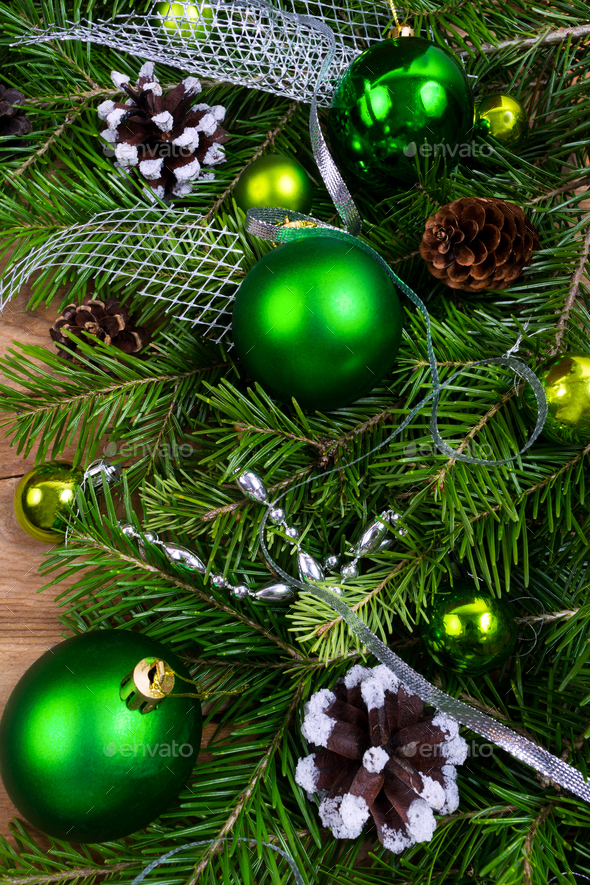 Christmas green baubles, pine cones and silver beads swag - Stock Photo - Images