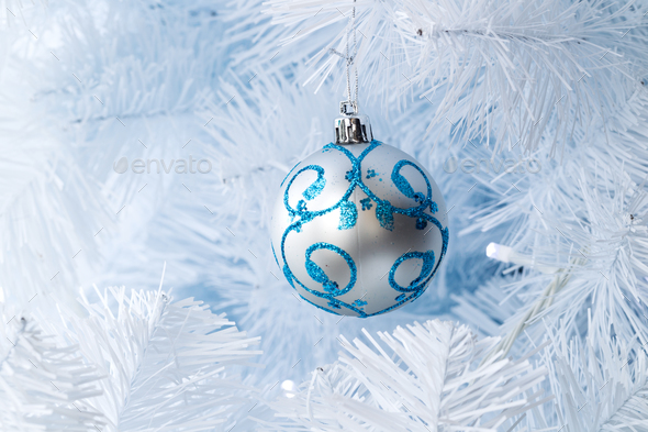 Christmas tree decorations hanging on a Christmas tree - Stock Photo - Images