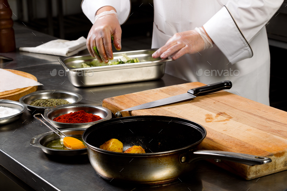 Cooking food. The hands of the chef make a salad - Stock Photo - Images