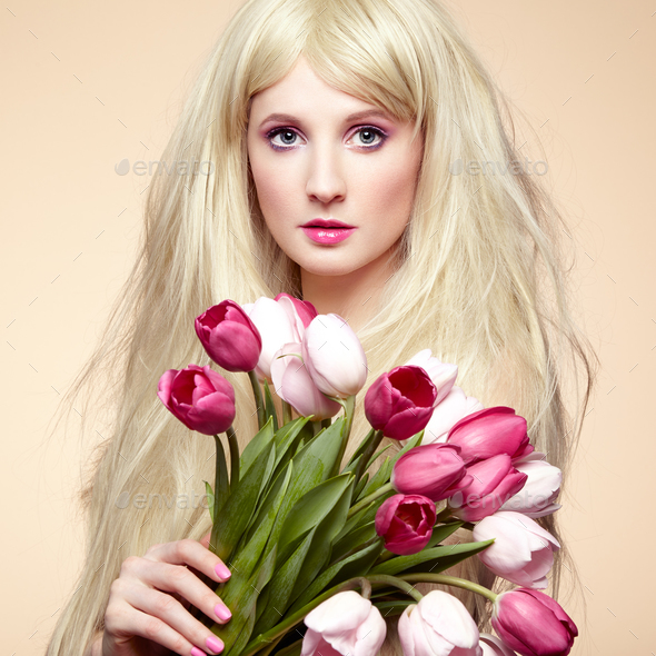 Portrait beautiful woman with bouquet of flowers - Stock Photo - Images