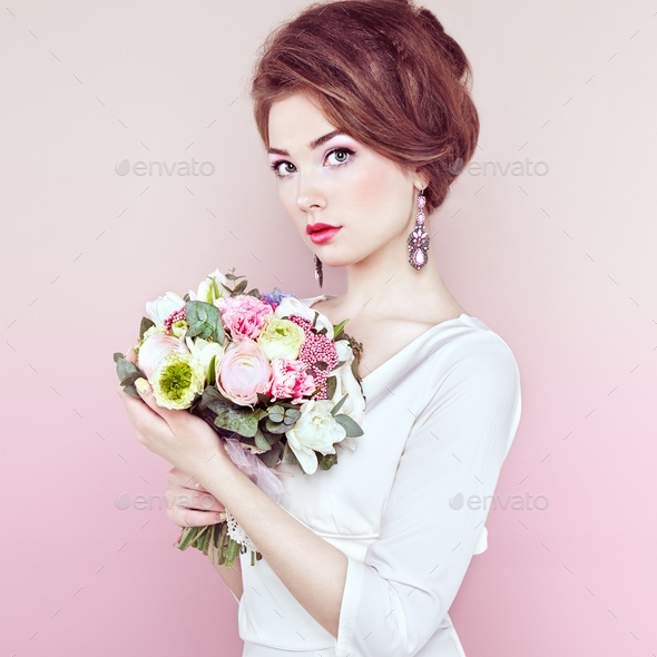 Woman with bouquet of flowers in her hands - Stock Photo - Images