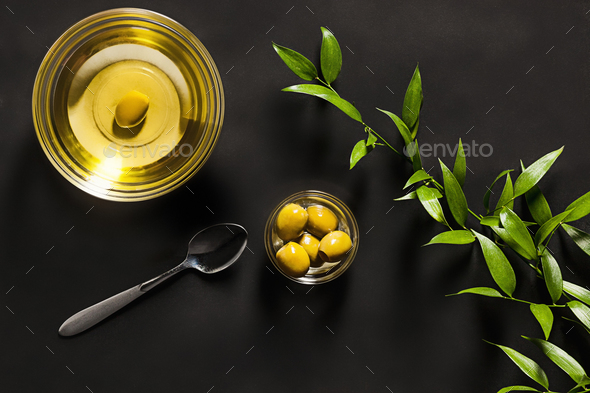 Olive oil and olive branch on the wooden table - Stock Photo - Images
