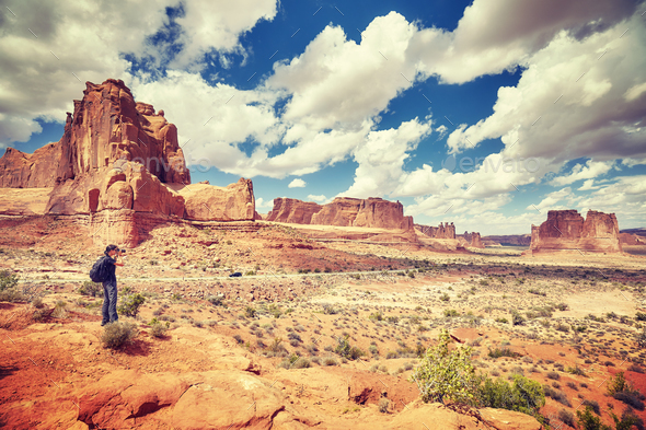 Female photographer takes pictures in Arches National Park. - Stock Photo - Images