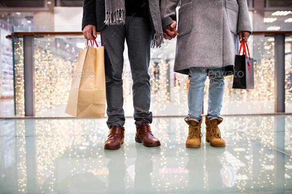 Senior couple doing Christmas shopping. - Stock Photo - Images
