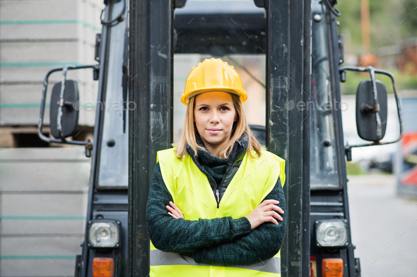 Woman forklift truck driver in an industrial area. - Stock Photo - Images