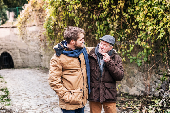 Senior father and his young son on a walk. - Stock Photo - Images