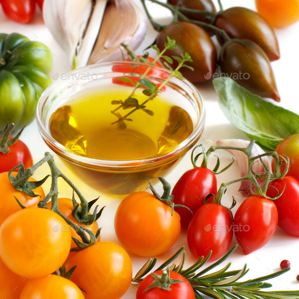 Colorful tomatoes, garlic, basil and oilve oil - Stock Photo - Images