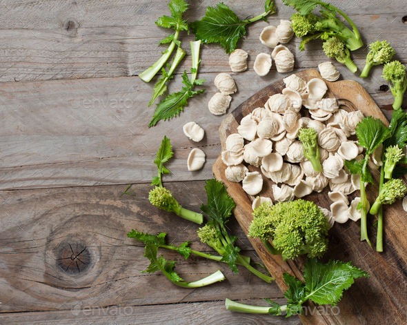Raw homemade Orecchiette pasta and turnip greens - Stock Photo - Images