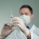 the Doctor Picks Up the Medicine in the Injection Syringe Ambulance Patient - VideoHive Item for Sale