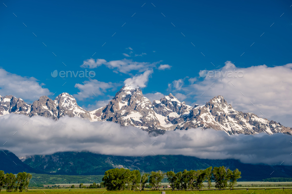 Grand Teton Mountains with low clouds - Stock Photo - Images