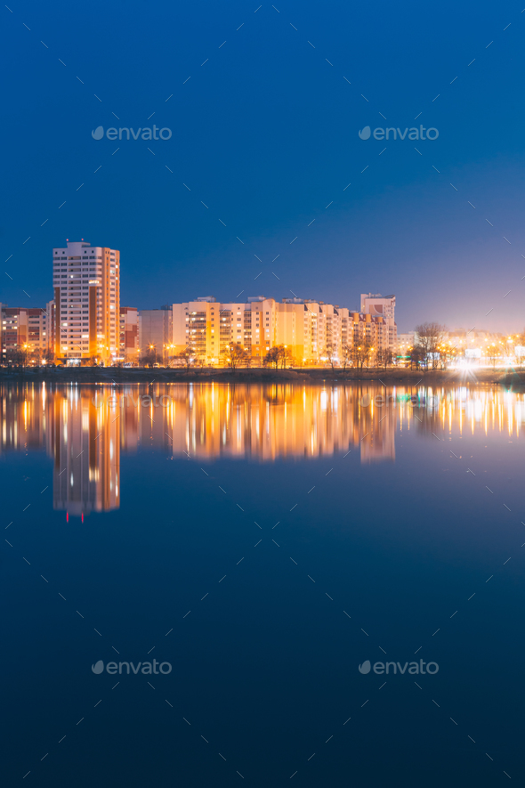 Night View Of Urban Residential Area Overlooks To City Lake Or R - Stock Photo - Images