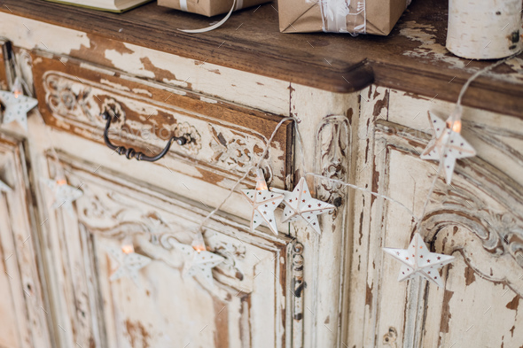 Christmas star and other decoration on ancient commode. Happy new year conception - Stock Photo - Images