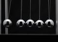 Closeup Of Newton Cradle With Swinging Metal Balls - PhotoDune Item for Sale