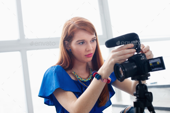 Woman Recording Vlog Video Blog Using DSLR Camera - Stock Photo - Images