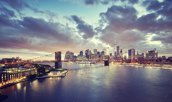 Vintage toned picture of a scenic sunset over New York. - Stock Photo - Images