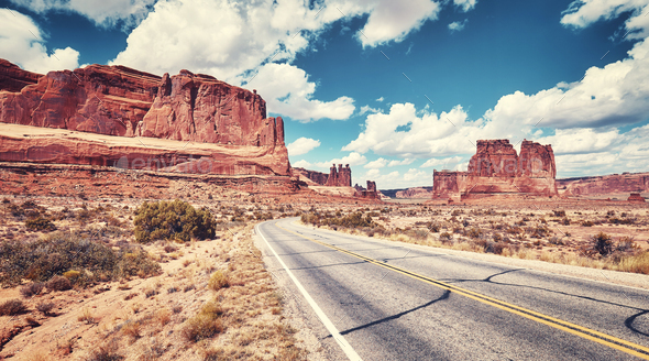 Vintage toned panoramic picture of a scenic road, USA. - Stock Photo - Images