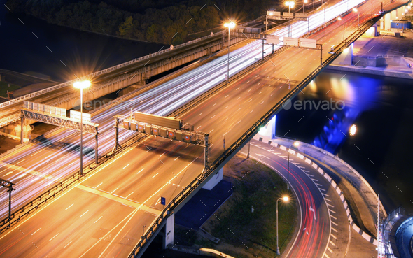 Road bridge across the river at night, view from above - Stock Photo - Images