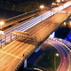 Road bridge across the river at night, view from above - PhotoDune Item for Sale