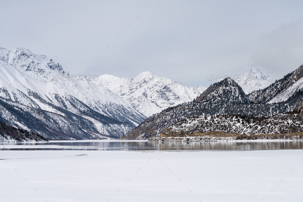 snow mountain and ice lake in winter - Stock Photo - Images