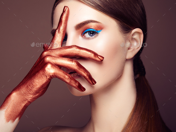 Portrait of beautiful young woman with art make-up - Stock Photo - Images