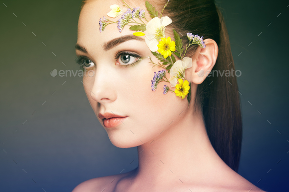 Face of beautiful woman decorated with flowers - Stock Photo - Images