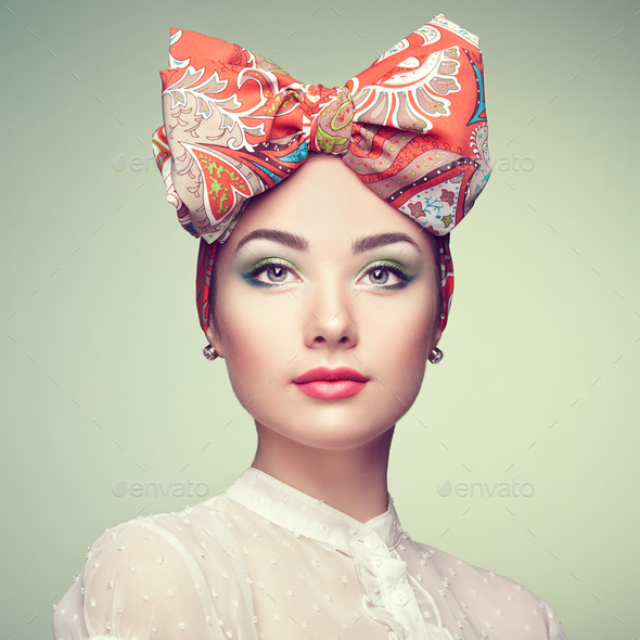 Portrait of beautiful young woman with bow - Stock Photo - Images
