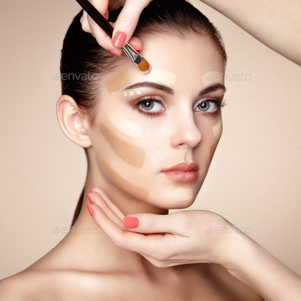 Makeup artist applies skintone - Stock Photo - Images