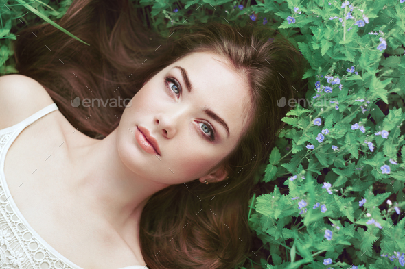 Portrait of a beautiful young woman in summer garden - Stock Photo - Images