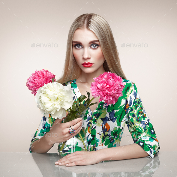 Fashion portrait of elegant woman with summer flowers - Stock Photo - Images