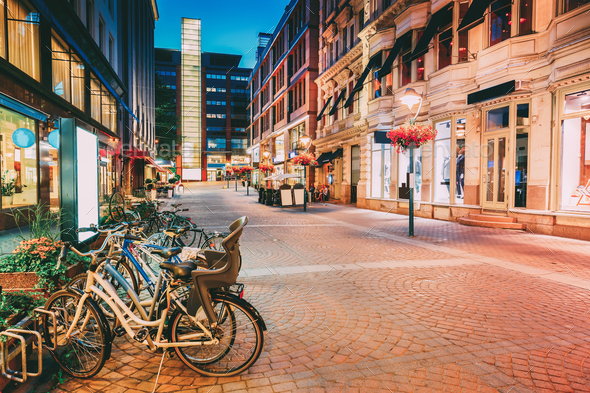 Helsinki, Finland. Bicycles Parked Near Storefronts In Kluuvikat - Stock Photo - Images