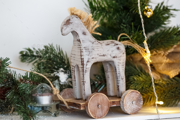 Rustic Christmas wooden horse toy on wooden surface, selected focus. - Stock Photo - Images