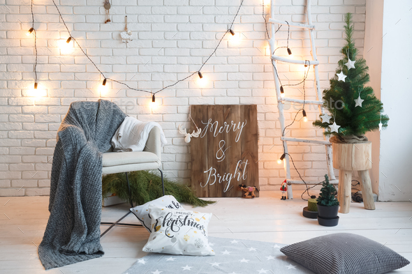 Winter home decor. Christmas tree in loft interior against brick wall. Ol - Stock Photo - Images
