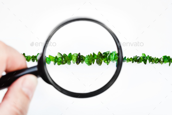 view of chrome diopside crystals through magnifier - Stock Photo - Images