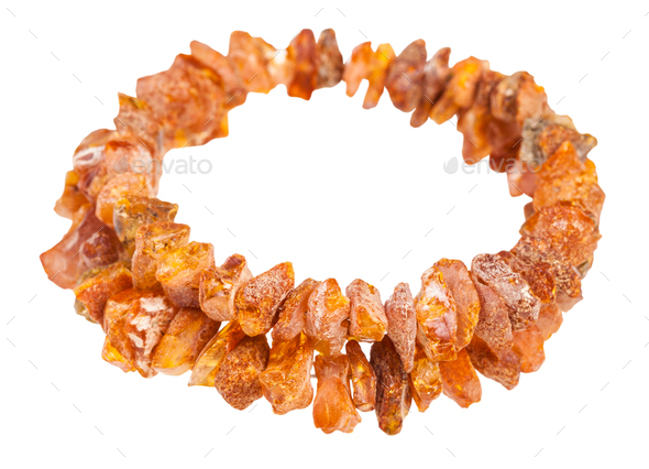 bracelet from rough amber stones isolated - Stock Photo - Images