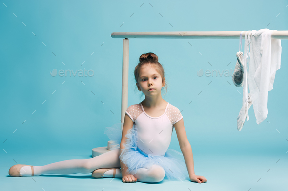 The little balerina dancer on blue background - Stock Photo - Images