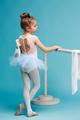 The little balerina dancer on blue background - PhotoDune Item for Sale