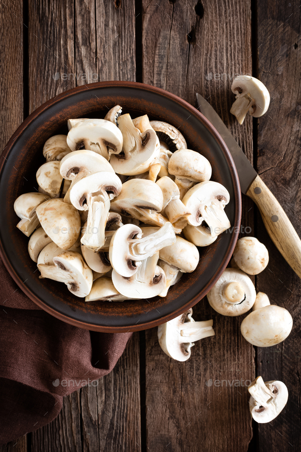 Fresh mushrooms on wooden table, top view - Stock Photo - Images