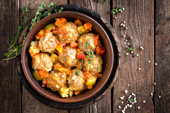 Meatballs stewed with vegetables on wooden table, top view - Stock Photo - Images